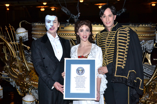 <i>Phantom of the Opera</i> stars Hugh Panaro, Marni Raab, and Kyle Barisich proudly show off their plaque from Guinness World Records in front of the musical's trademark chandelier.