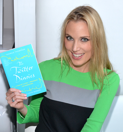 Imogen Lloyd Webber shows off a copy of her new book, <i>The Twitter Diaries</i>.