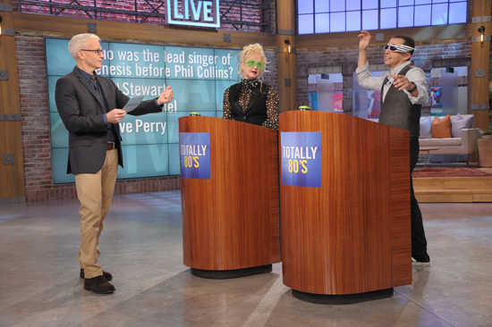 Anderson Cooper hosts a game of 1980s trivia with players Cyndi Lauper and Jon Cryer