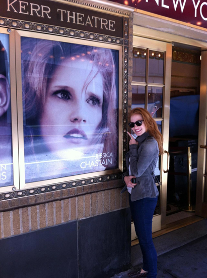 Jessica Chastain points to her photo on the side of the Walter Kerr Theatre