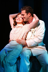 Kate Jennings Grant as Sarah Brown, a few too many dulce de leches under her belt, falls for Craig Bierko's Sky Masterson in <i>Guys and Dolls</i>.