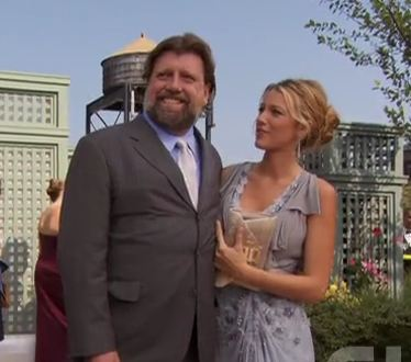 Oskar Eustis and Blake Lively stop for a photo at a rooftop party.