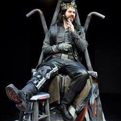 Aaron Kirkpatrick as Richard III ruling his biker-inspired throne in Indiana University's current production of <i>Richard III</i>
