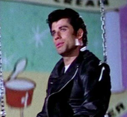 "John Travolta sings ""Sandy."""