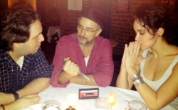 "Richard Schiff (center) puts a knife to ""The West Wing Song"" with his co-conspirators: David Babani (left) and Alexandra Silber (right)."