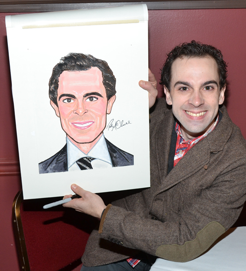 Rob McClure, currently starring as Charlie Chaplin in Broadway's <i>Chaplin</i> proudly shows off his brand new Sardi's caricature.