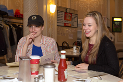 <i>Bad Jews</i> cast members Tracee Chimo and Molly Ranson face a tough decision: what to order at the Cafe Edison.