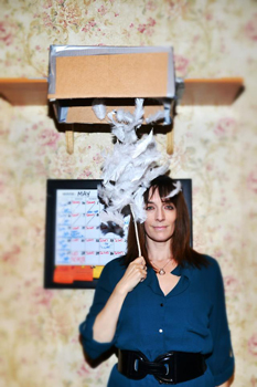 Julia Murney and a box of feathers, which is featured prominently in <i>Falling</i>.
