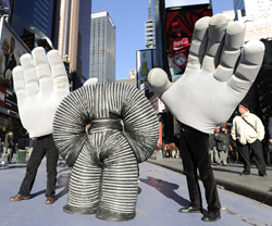 Slinky Man and the two Giant Hands, three of the new <i>Mummenschanz</i> characters, take over Times Square.