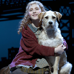 Lilla Crawford and Sunny in <i>Annie</i> at the Palace Theatre.