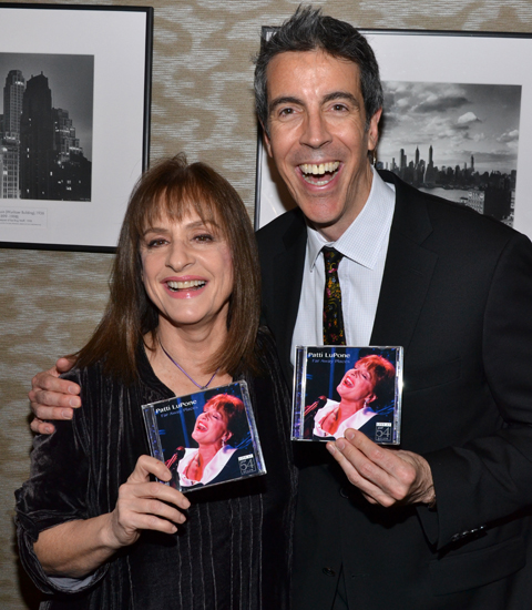 Patti LuPone and musical director Joseph Thalken show off copies of her new album, &lt;i&gt;Far Away Places&lt;/i&gt;, backstage at Barnes &amp; Noble.
