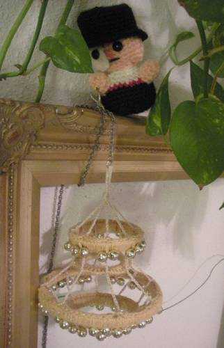 A crocheted Phantom and his chandelier.
