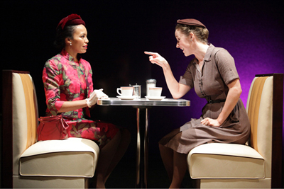 Eisa Davis and Amanda Quaid's teacup dialogue gets heated in Kirsten Greenidge's <i>Luck of the Irish</i>, now playing at Lincoln Center.