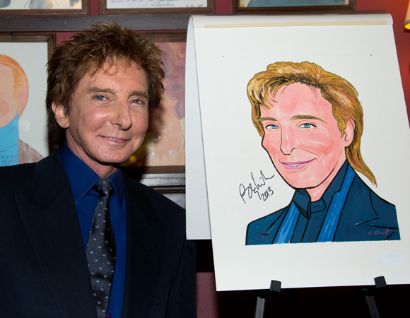Barry Manilow alongside his brand new Sardi's caricature.