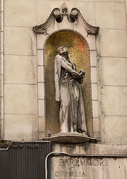 A statue of Ethel Barrymore on the facade of the I. Miller building in Times Square.