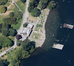 An aerial view of the Bathhouse in the summer, surrounded by bathers.