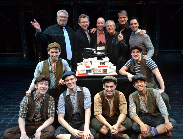 The newsboys share a photo with the <i>Newsies</i> creative family: book writer Harvey Fierstein, producer Thomas Schumacher, lyricist Jack Feldman, composer Alan Menken, director Jeff Calhoun, and choreographer Christopher Gattelli.