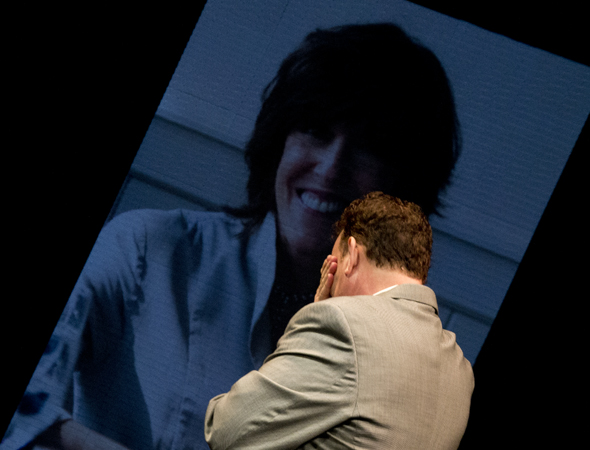 Hanks breaks down as he views a projected portrait of his friend and longtime collaborator, the late <i>Lucky Guy</i> playwright, Nora Ephron.<br />(© David Gordon)
