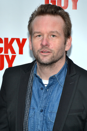 Dallas Roberts poses for photos on his way into the Broadhurst Theatre.<br />(© David Gordon)