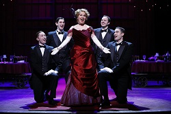 Nancy Opel as Dolly Levi with JP Qualters, Harris Milgrim, Alex Puette, and Kyle Vaughn in the Ford's and Signature Theatre co-production of <I>Hello, Dolly!</