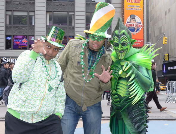 March 17 – In honor of St. Patrick's Day, <i>Spider-Man: Turn Off the Dark</i>'s Green Goblin (Robert Cuccioli) hits Times Square to revel in the celebrations.<br />(© Monica Simoes/<i>Spider-Man Turn Off the Dark</i>)