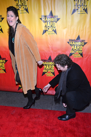 March 21 – Sebastian Arcelus helps rescue his wife Stephanie J. Block after she gets her heel caught in the sidewalk.<br />(© David Gordon)