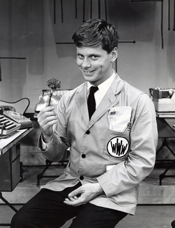 Robert Morse, who costars as the eccentric senior partner Bert Cooper, shot to fame as J. Pierrepont Finch in the original Broadway production and film version of the musical <i>How to Succeed in Business Without Really Trying</i>.<br />(Image via www.mtishowspace.com)