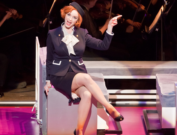 Christina Hendricks, an Emmy Award nominee for her role as hard-boiled office manager Joan Harris, starred as flight attendant April in the 2011 New York Philharmonic concert staging of Stephen Sondheim's <i>Company</i>, opposite Neil Patrick Harris.<br />(© Chris Lee)