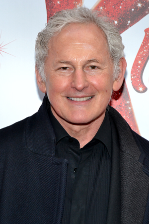 Tony Award nominee Victor Garber smiles for the camera on his way into the Al Hirschfeld Theatre.<br />(© David Gordon)