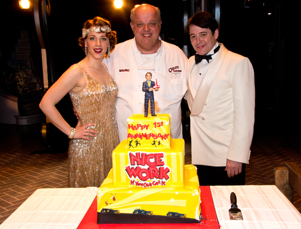 Before they get out of costume, Jessie Mueller and Matthew Broderick flank the cake's creator, chef Mauro Castano of Carlo's Bakery.<br />(© David Gordon)