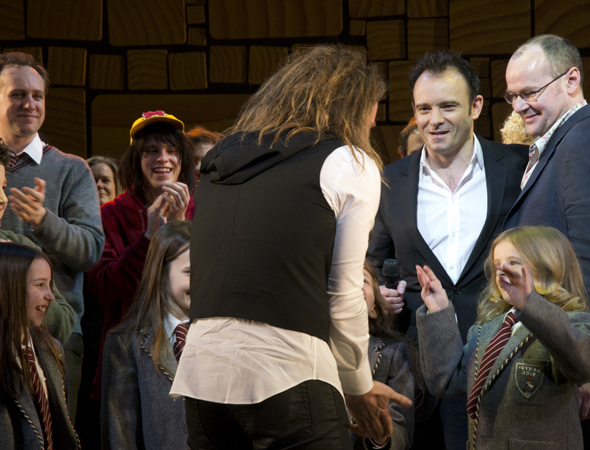 As director Matthew Warchus and book writer Dennis Kelly look on, composer/lyricist Tim Minchin high-fives his young stars.<br />(© David Gordon)