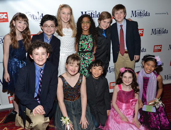 The children of <i>Matilda</i> show off their party clothes.<br />(© David Gordon)