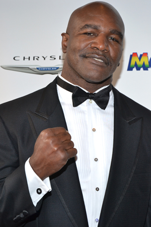 Boxer Evander Holyfield shows us his iron fist.<br />(© David Gordon)