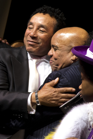 Smokey Robinson joins Berry Gordy for a bear hug.<br />(© David Gordon)