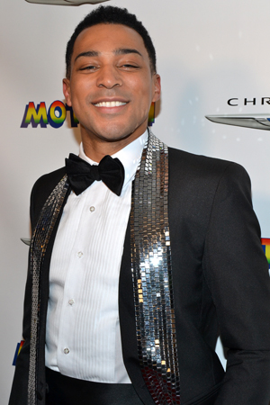 Charl Brown, who plays Smokey Robinson, flashes his pearly whites and shimmer scarf. <br />(© David Gordon)