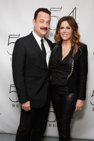 Tom Hanks poses with his wife, actress/singer Rita Wilson, backstage following her performance at 54 Below on April 14.<br />(© Cindy Ord/Getty Images for 54 Below)