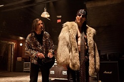 Alec Baldwin and Tom Cruise in the movie <i>Rock of Ages</i>