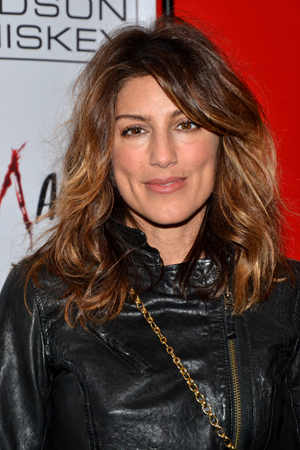 Jennifer Esposito (<i>Crash</i>) poses for photos on her way into the afterparty.<br />(© David Gordon)