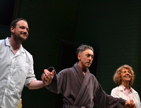 <i>Macbeth</i> stars Jenny Sterlin, Brendan Titley, and Alan Cumming share a bow on opening night.<br />(© David Gordon)