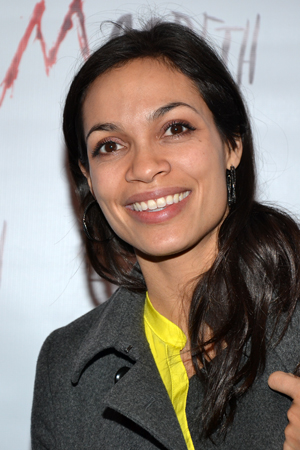 Rosario Dawson, who costarred with Alan Cumming in the 2001 film <i>Josie and the Pussycats</i> smiles for the cameras on her way into the afterparty.<br />(© David Gordon)