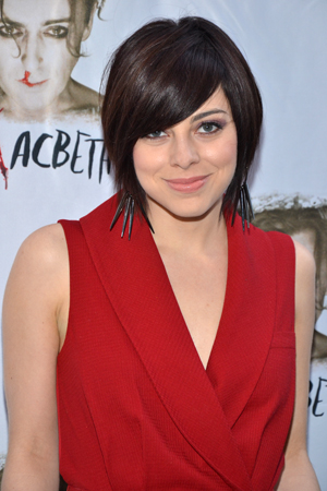<i>Smash</i>'s Krysta Rodriguez smiles for the cameras.<br />(© David Gordon)