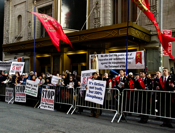 "Protesters gather across the street from the Walter Kerr Theatre to proclaim <i>The Testament of Mary</i> ""blasphemous.""<br />(© David Gordon)"