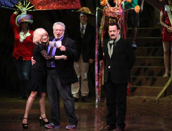 Cyndi Lauper and Harvey Fierstein hug as Tom Hanks looks on.<br />(© David Gordon)