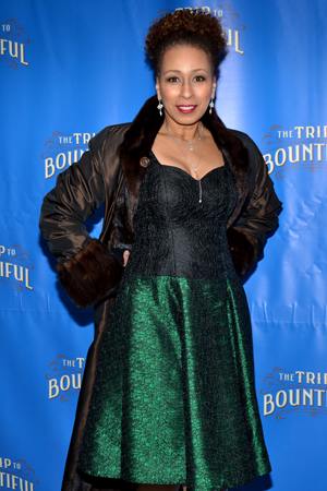 Tony Award-winning producer Tamara Tunie (<I>Spring Awakening</I>) looks dashing in her full-length coat and emerald-green dress.<br />(© David Gordon)
