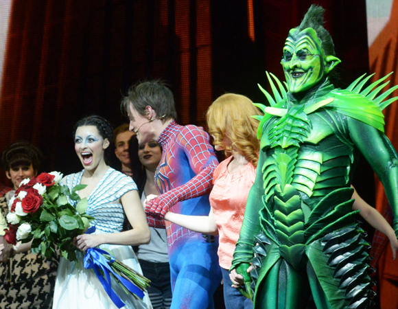 Christina DeCicco (left) takes her first curtain call in <i>Spider-Man Turn Off the Dark</i>.