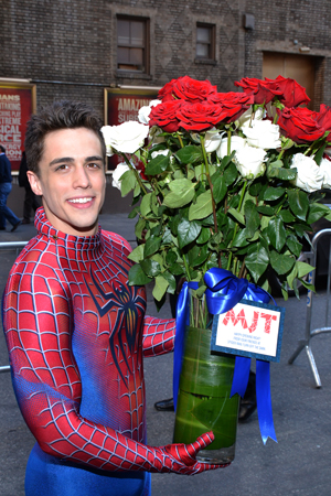 One of the spider men of <i>Spider-Man Turn Off the Dark</i> even makes an appearance to deliver this bouquet of flowers to the show's former comrade, <i>Pippin</i> star Matthew James Thomas.<br />(© David Gordon)