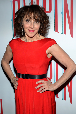 "Andrea Martin, whose showstopper ""No Time At All"" routinely receives mid-show standing ovations, is also rocking a red dress.<br />(© David Gordon)"