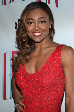 Leading Player Patina Miller is a dazzling lady in red.<br />(© David Gordon)
