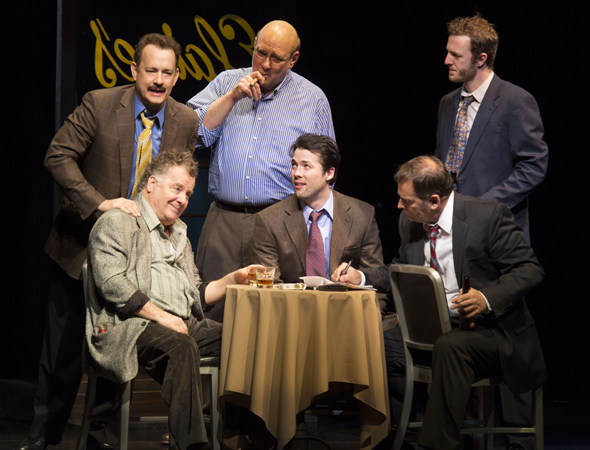 Tom Hanks (standing, far left) led the ensemble cast of Nora Ephron's final play, <i>Lucky Guy</i>, which opened at the Broadhurst Theatre on April 1 under the direction of George C. Wolfe.<br />(© Joan Marcus)