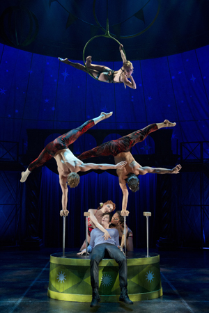 Matthew James Thomas (seated) plays the title role in American Repertory Theater's revival of <i>Pippin</i>, finishing out the season on April 25 at the Music Box Theatre. Diane Paulus directs the production, which also features Patina Miller, Andrea Martin, Charlotte d'Amboise, Terrence Mann, and Rachel Bay Jones.<br />(© Joan Marcus)